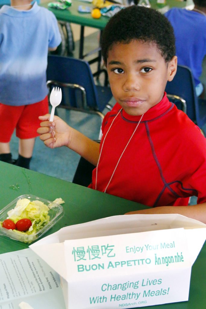 Jayden Rhodes enjoys his salad provided by NDS' summer meals program.