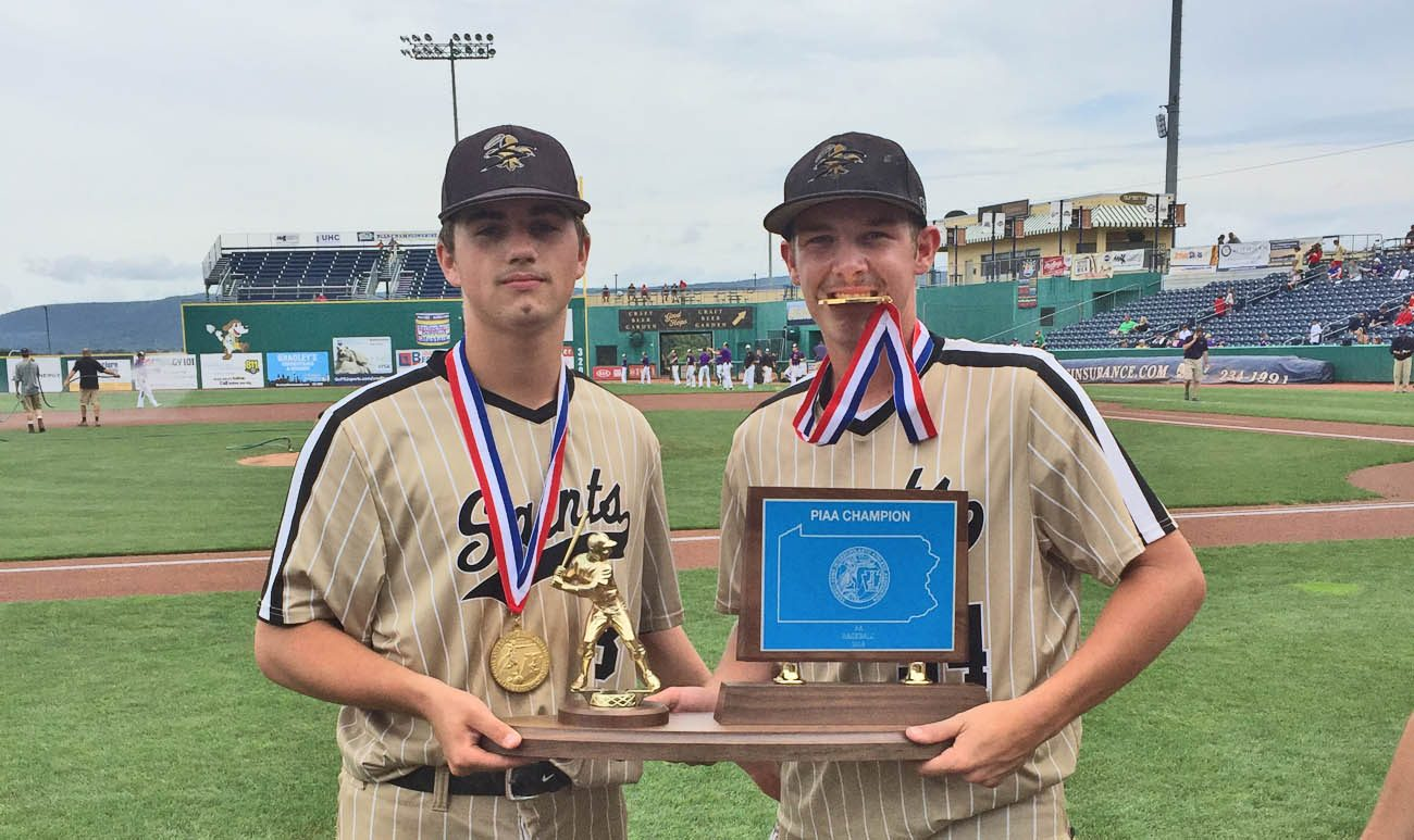 Neumann-Goretti players show off their state PIAA baseball championship medals and trophy -- the first baseball title in school history -- June 16 at Penn State University. (John Knebels)