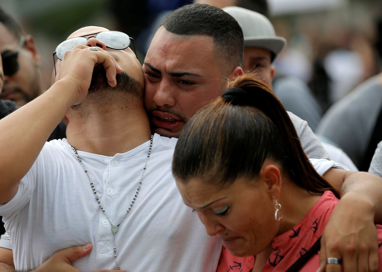 Mourners grieve at a June 13 vigil for the victims of the mass shooting at the Pulse gay nightclub in Orlando, Fla. A lone gunman, pledging allegiance to the Islamic State terrorist group, killed 49 people early June 12 at the nightclub. (CNS photo/Jim Young, Reuters)