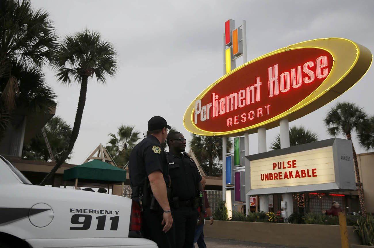 Police provide security during a June 12 candlelight vigil at the Parliament House Resort in Orlando, Fla. As grief and shock turn to worry following the worst mass shooting in modern U.S. history, security and policing experts are looking for long-term lessons from the June 12 tragedy in Orlando. (CNS photo/Jim Young, Reuters)