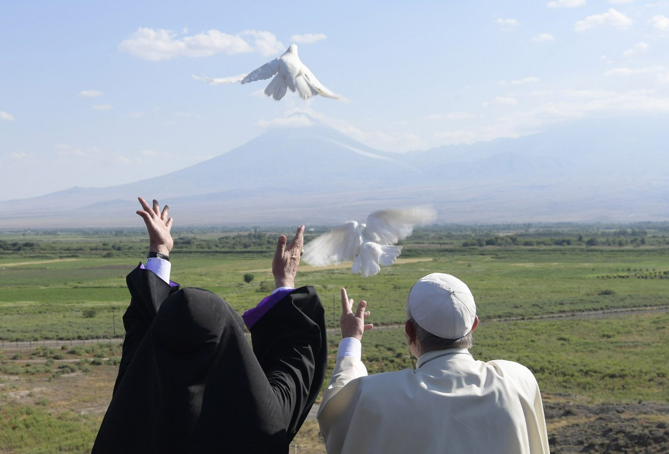 Pope Francis and Catholicos Karekin II, patriarch of the Armenian Apostolic Church, release doves from the Khor Virap monastery near Lusarat village in Armenia June 26. In the background is Mount Ararat, believed to be where Noah's Ark came to rest. (CNS photo/L'Osservatore Romano, handout)