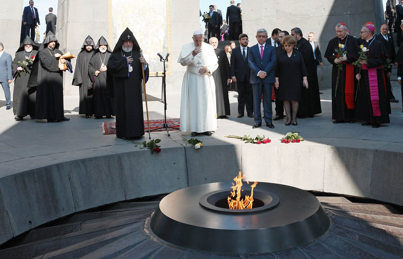 Pope Francis Armenian President Serzh Sargsyan attend a service at the Tsitsernakaberd Memorial in Yerevan, Armenia, June 25. The monument honors the estimaged 1.5 million Armenians killed by Ottoman Turks in 1915-18. (CNS photo/Paul Haring)