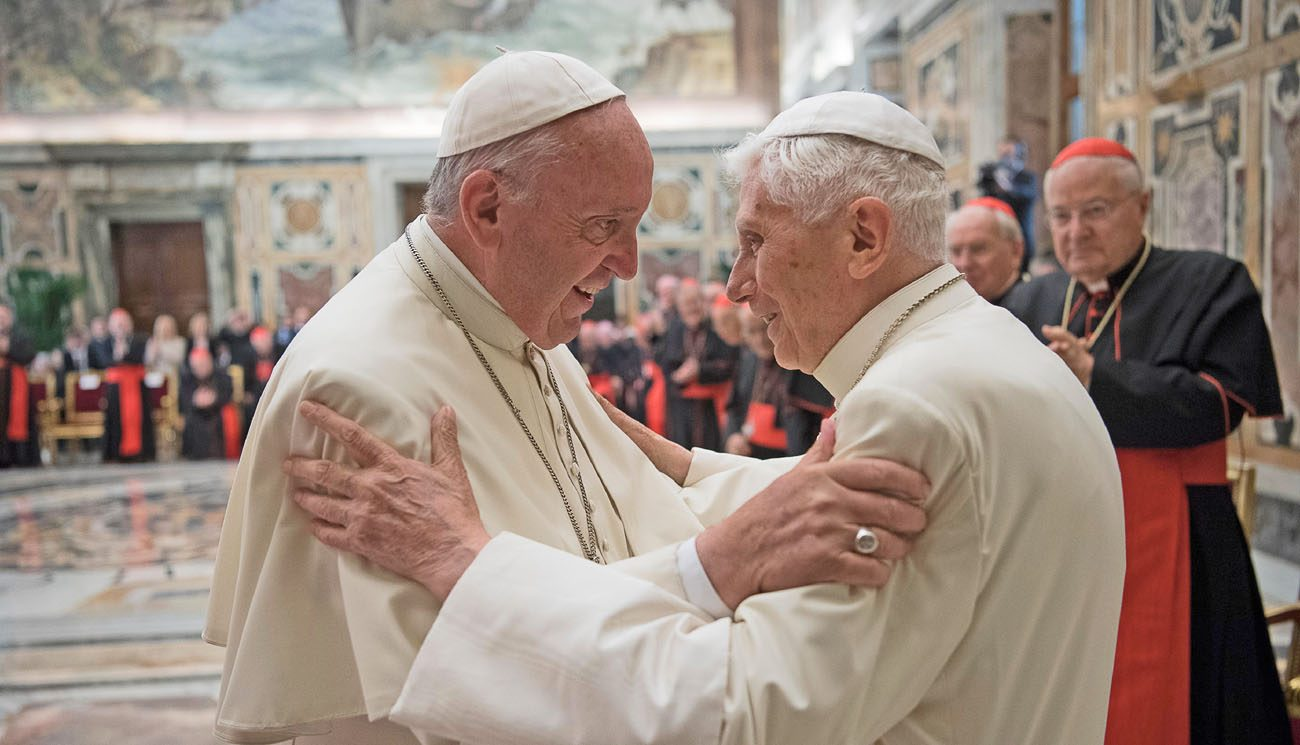 Pope Francis greets retired Pope Benedict XVI during a June 28 ceremony at the Vatican marking the 65th anniversary of the retired pope's priestly ordination. (CNS photo/L'Osservatore Romano, handout)