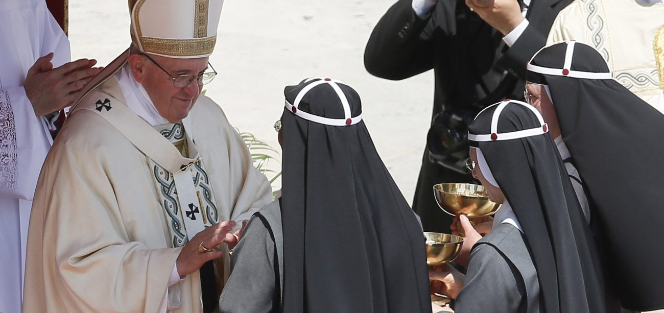 Pope Francis accepts offertory gifts from Bridgettine sisters as he celebrates the canonization Mass for two new saints in St. Peter's Square at the Vatican June 5. (CNS photo/Paul Haring)