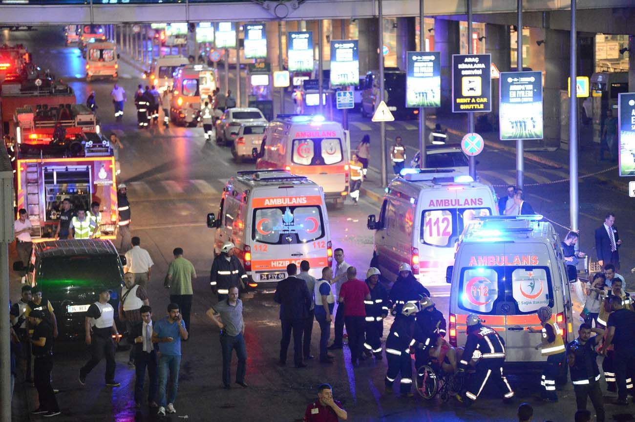 Paramedics help people outside Istanbul's Ataturk Airport following a June 28 suicide attack. The bombings killed dozens and wounded more than 200 as Turkish officials blamed the carnage at the international terminal on three suspected Islamic State group militants. (CNS photo/Ismail Coskun, IHLAS News Agency via Reuters)