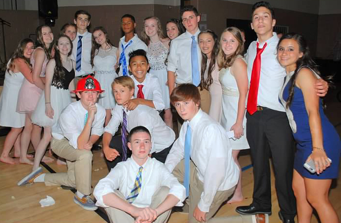 Students enjoy a school dance after their graduation from Holy Cross School.