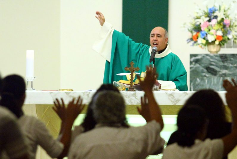 Father Rodolfo de Vasconcelos celebrates Mass in Portuguese on Saturday, June 6 at St. Martin of Tours Church in Philadelphia.