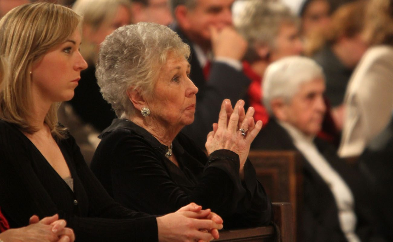 Joan Sheen Cunningham, niece of the late Archbishop Fulton J. Sheen, prays with her family during a 2009 memorial Mass for her uncle at St. Patrick's Cathedral in New York.  (CNS photo/Gregory A. Shemitz)