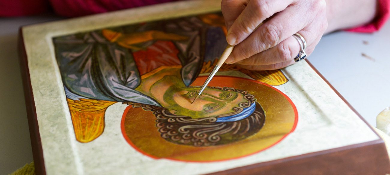 Marianist Brother Gary Marcinowski, a professor of sculpture at the University of Dayton, adds detail to an icon he created during a weeklong workshop on the ancient art form at the Shrine of St. Anthony in Ellicott City, Md., April 25. (CNS photo/Kevin J. Parks, Catholic Review)