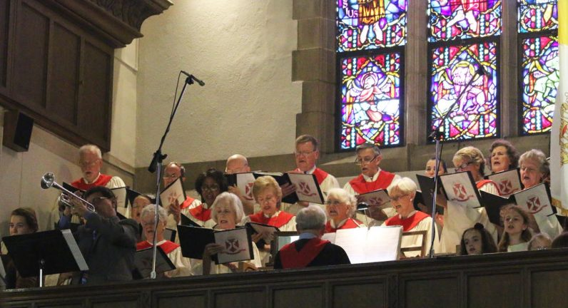 The St. Andrews choir, featuring adults, children and soloists, leads the congregation in song at the June 25 100th anniversary Mass for the parish.