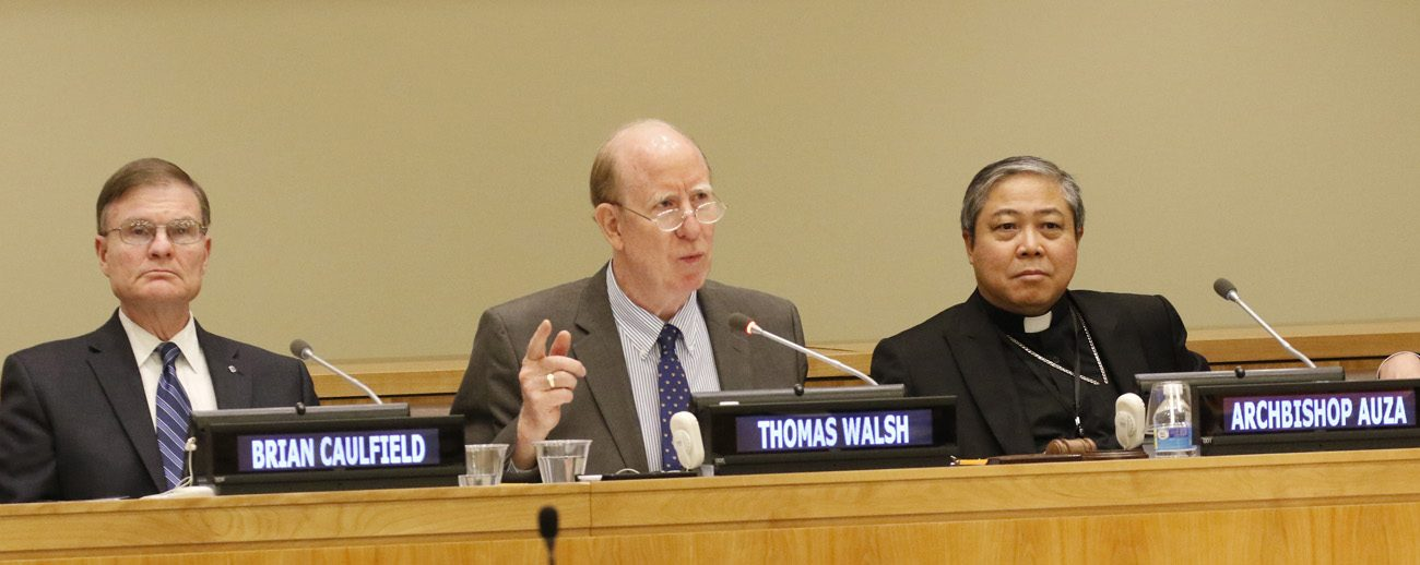 Thomas Walsh, president of the Universal Peace Federation, speaks during a conference at the United Nations June 1 on the importance of motherhood and fatherhood for the integral development of men, women, children and society. Also pictured are Brian Caulfield, left, editor of FathersForGood.org, and Archbishop Bernardito Auza, the Vatican's permanent observer to the U.N. The Holy See mission to the U.N. and the Universal Peace Federation were co-sponsors of the event. (CNS photo/Gregory A. Shemitz)