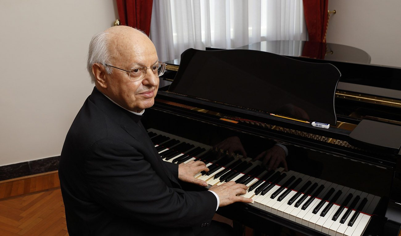Cardinal Lorenzo Baldisseri, general secretary of the Synod of Bishops, plays the piano in his office at the Vatican June 15. Cardinal Baldisseri, who just released his third CD, said playing the piano helps his priestly vocation to reach others with the Gospel. (CNS photo/Paul Haring)