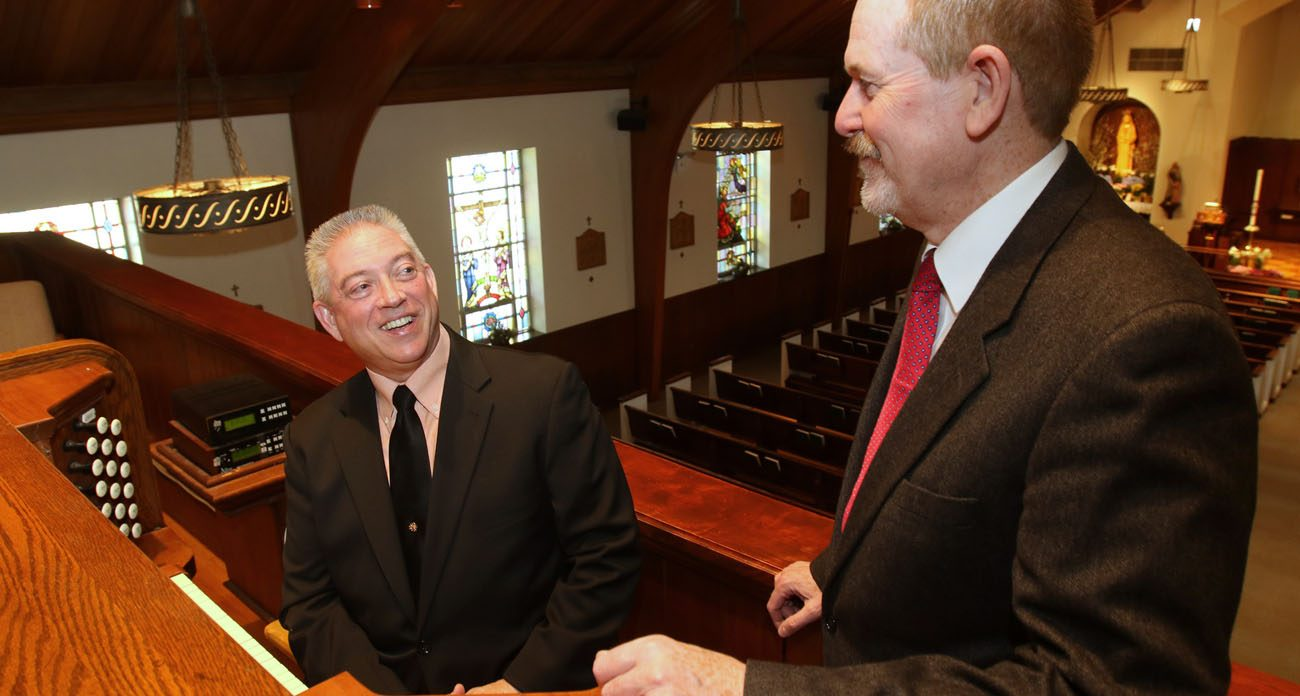 Organist Paul Cartier chats with Raymond Henderson, liturgical music director at Our Lady of Hope Parish in 2015 in Carle Place, N.Y. Organist Paul Cartier chats with Raymond Henderson, liturgical music director at Our Lady of Hope Parish in 2015 in Carle Place, N.Y. A new Department of Labor rule raises the salary threshold for overtime pay for many workers, meaning some parish staffs and other employers will have to readjust their budgets to accommodate the increased personnel costs. (CNS photo/Gregory A. Shemitz)