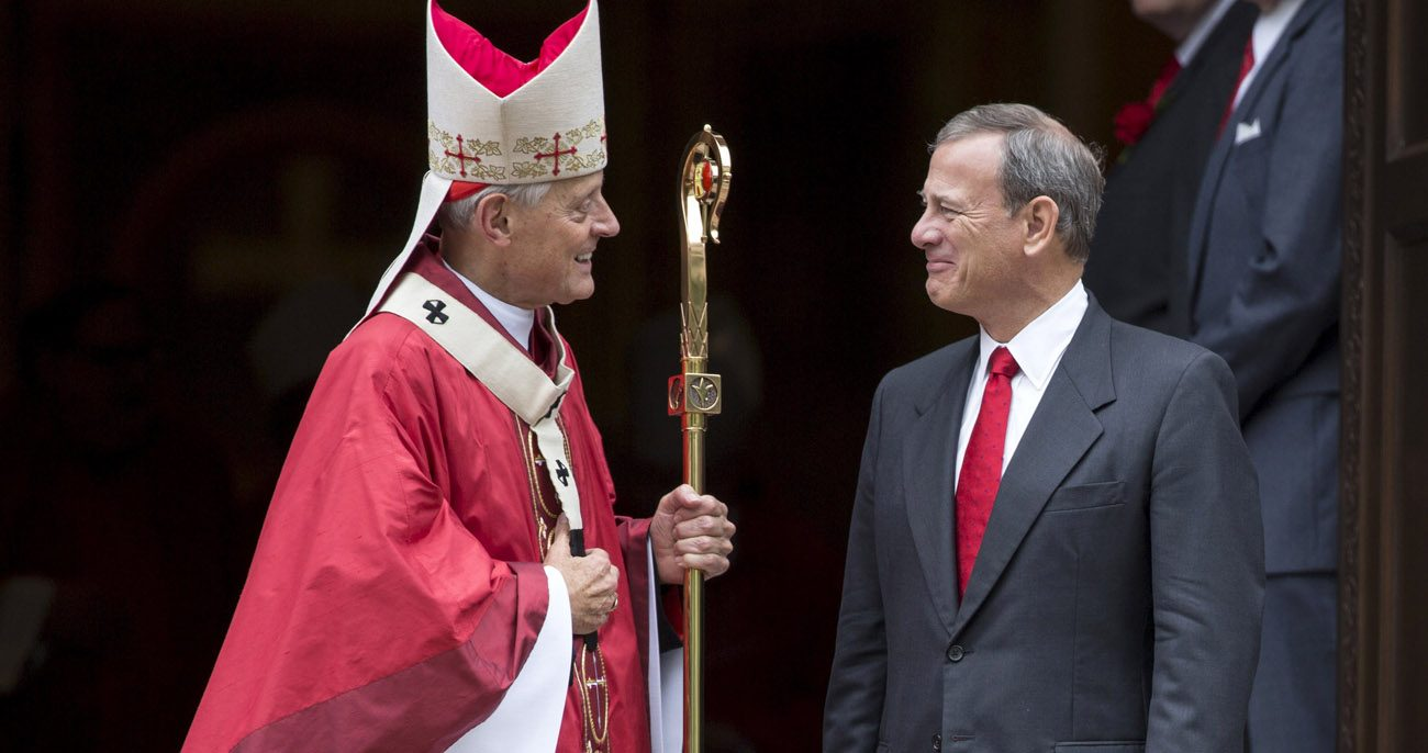 Cardinal Donald W. Wuerl of Washington talks with U.S. Chief Justice John Roberts as they leave the Cathedral of St. Matthew the Apostle in Washington after the annual Red Mass in this Oct. 4. 2015, file photo. (CNS photo/Joshua Roberts, Reuters)