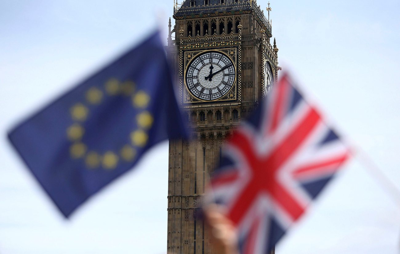 A European Union flag and British Union flag are seen at Parliament Square in London June 19. Voters in the United Kingdom voted June 23 to leave the European Union. (CNS photo/Neil Hall, Reuters)