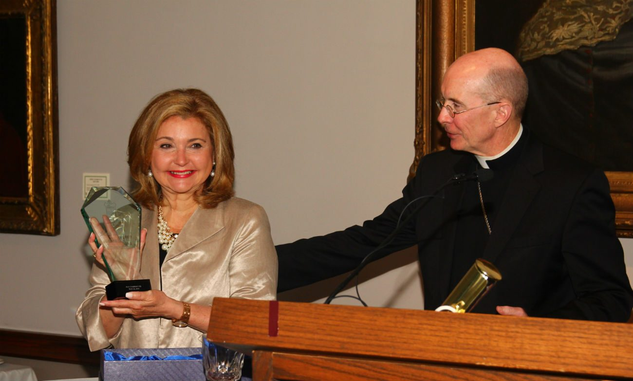 Former CBS3 television news anchor Pat Ciarrocchi accepts the inaugural Cardinal Foley Award May 26 at St. Charles Borromeo Seminary from its rector, Bishop Timothy Senior. (Photo by Sarah Webb)