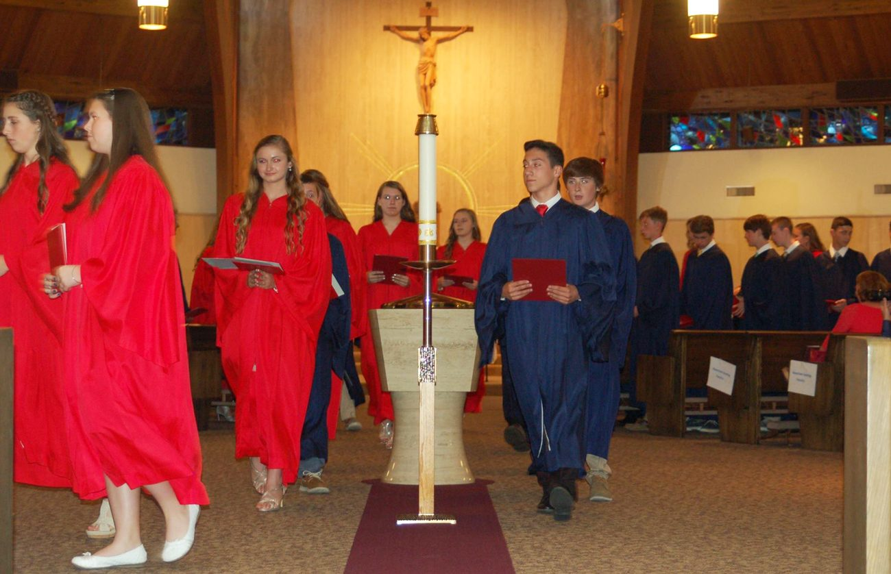 Students of Holy Cross Regional Catholic School receive recognition for eighth grade graduation June 14 at St. Eleanor Church, Collegeville.
