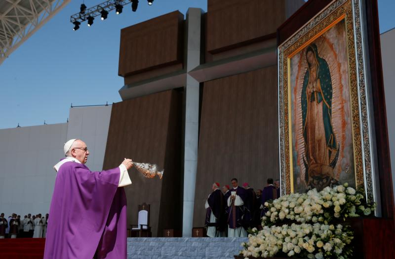 Pope Francis uses incense to venerate an image of Our Lady of Guadalupe during Mass in Ecatepec near Mexico City Feb. 14. While the church has rejected the legitimacy of some Marian appearances, it has not made judgment on most of them. Some appearances, however, have been recognized by the church as legitimate, including those at Guadalupe, Mexico, in 1531; Siluva, Lithuania, in 1608; the appearance to St. Catherine Laboure in Paris in 1830. (CNS photo/Paul Haring)