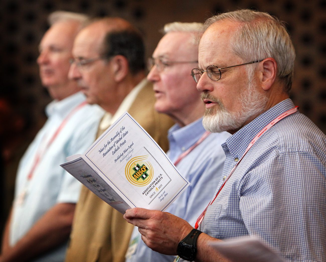 Priests sing during Mass June 30 at the Association of U.S. Priests gathering in Chicago. About 200 members from around the country attend the annual event. (CNS photo/Karen Callaway, Catholic New World)