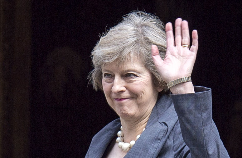 British Home Secretary Theresa May waves as she arrives July 12 to attend the last Cabinet meeting hosted by British Prime Minister David Cameron. (CNS photo/Will Oliver, EPA)