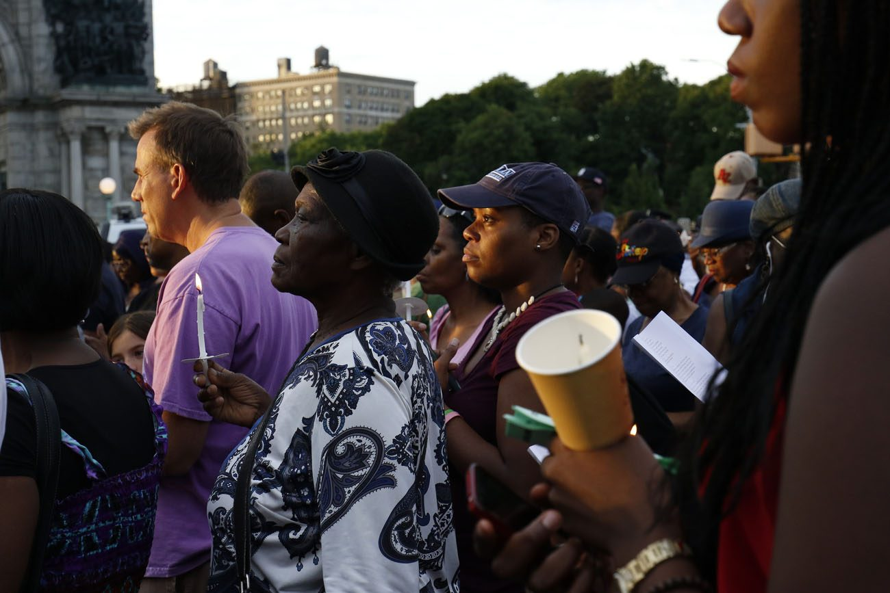People participate in a candlelight vigil July 11 at Grand Army Plaza in the Prospect Heights section of Brooklyn, N.Y.  (CNS photo/Gregory A. Shemitz)