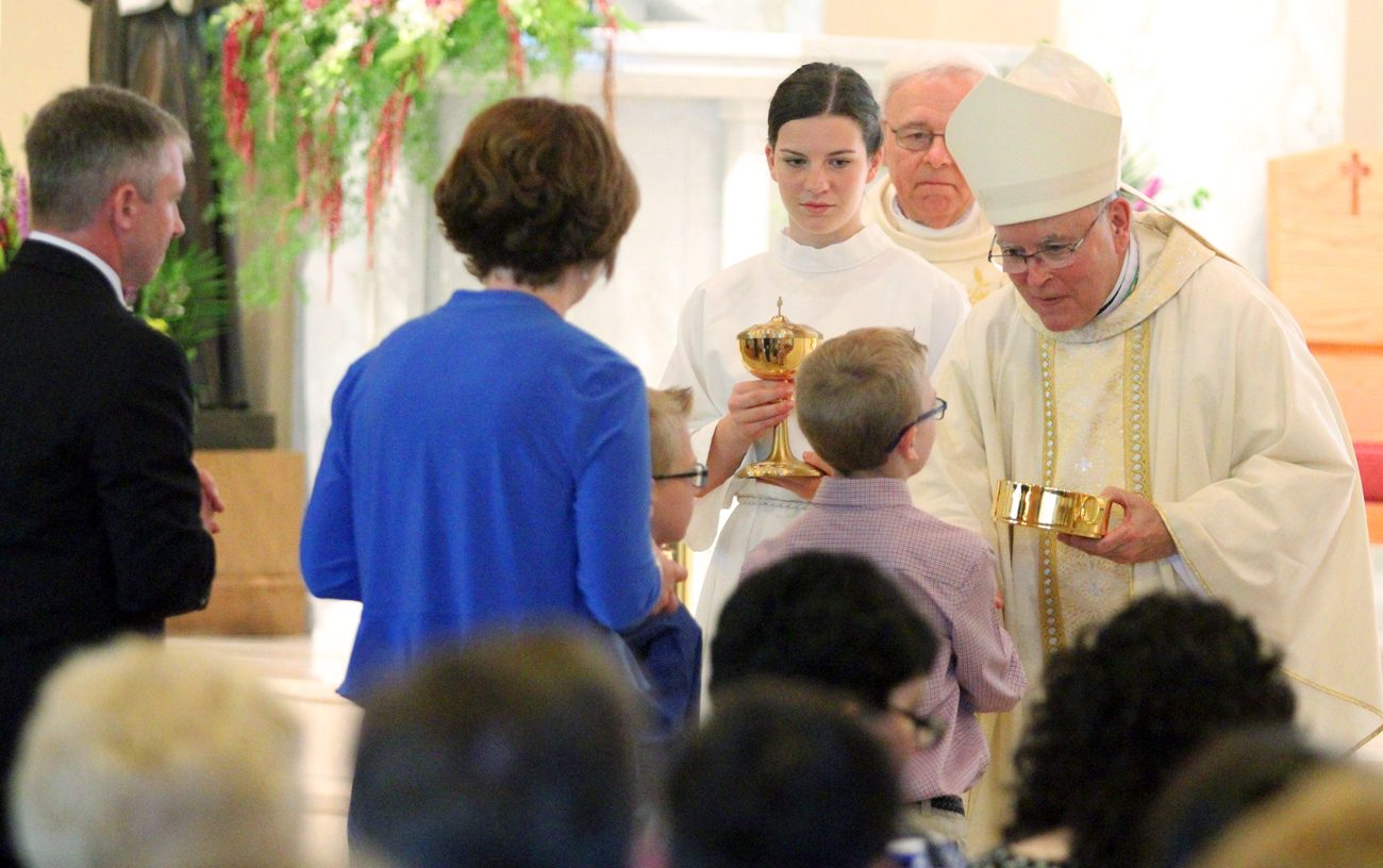 Archbishop Charles Chaput greets a family at St. Bede the Venerable Parish in Holland in this May 2015 file photo. (Sarah Webb)