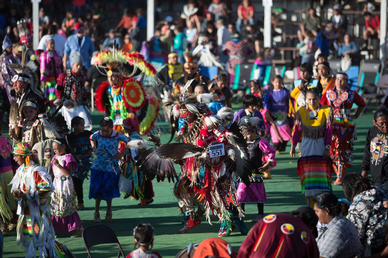 Native Americans representing 50 tribes from across the United States and Canada gather for a powwow July 9 during North American Indian Days in Browning, Mont. The event has been running for 65 years. (CNS photo/courtesy Catholic Extension)
