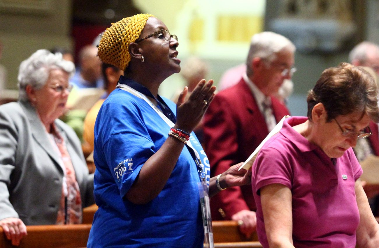 Janet A. Mills, a volunteer for the Democratic National Convention in Philadelphia and a member of Janes Memorial United Methodist Church in the city's Mount Airy section, raises her voice in song at the Interfaith service of Prayer for the Nation July 25 at the Cathedral Basilica of SS. Peter and Paul, Philadelphia. (Photo by Sarah Webb)