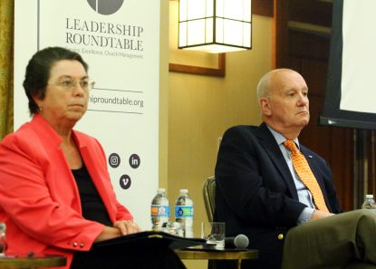 """Barbara Ann Cusack, chancellor for the Archdiocese of Milwaukee, and Jim Herrel, administrator of St. Anne Parish in Marietta Ga., participate in a panel discussion titled """"Changing Church Culture: Institutionalizing Best Managerial Practices in Every Diocese."""" Sarah Webb)"""