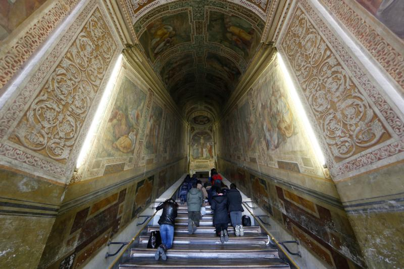 "People walk on their knees as they pray at the Holy Stairs in Rome March 10, 2014. The Holy Stairs, or Scala Santa, are seen in the 3-D documentary ""St. Peter's and the Papal Basilicas of Rome."" (CNS photo/Paul Haring)"