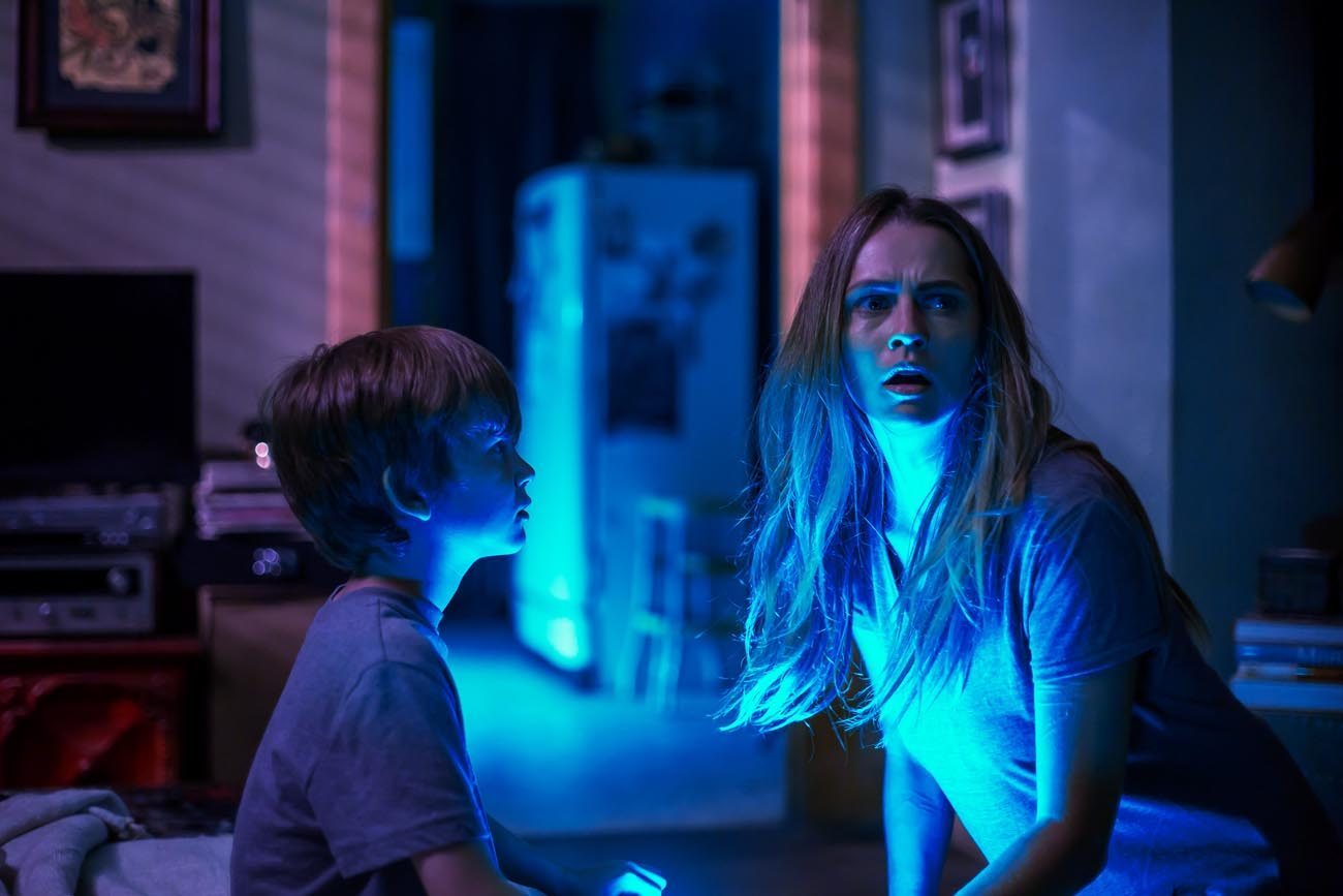 "Gabriel Bateman and Teresa Palmer star in a scene from the movie ""Lights Out.""  (CNS photo/Warner Bros.)"