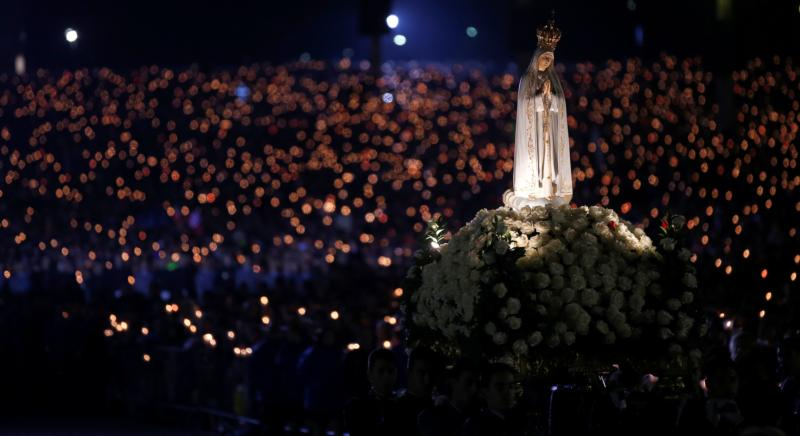 A statue of Our Lady of Fatima is carried through the crowd May 12 at the Marian shrine of Fatima in central Portugal. (CNS photo/Rafael Marchante, Reuters)