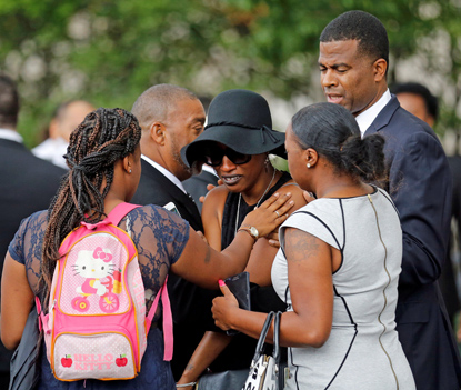 Family members comfort Diamond Reynolds, the girlfriend of Philando Castile, as his casket arrives July 14 for a funeral service at the Cathedral of St. Paul in St. Paul, Minn. (CNS photo/Eric Miller, Reuters)