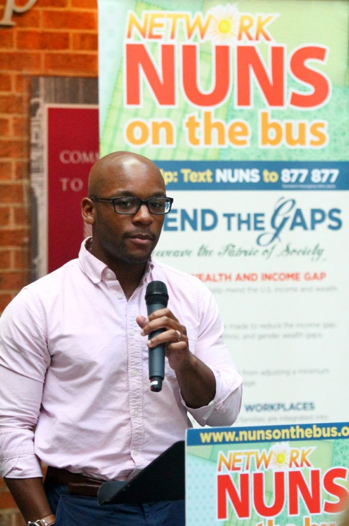 During the closing rally of Nuns on the Bus at St. Joseph's Prep in Philadelphia, Terrell Johnson from Health Federation of Philadelphia tells of the importance of health insurance to him when he almost went blind.