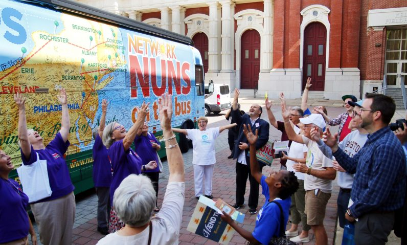 After the rally at St Joseph's Preparatory School in Philadelphia those in attendance gather at the bus for one last moment of praise to God together.