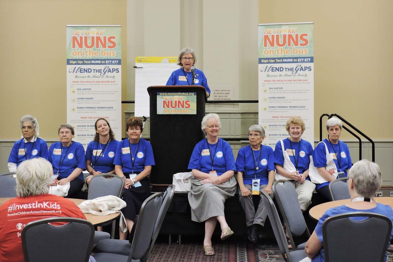Sister Simone Campbell, a Sister of Social Service, stands at the podium July 26 during a workshop sponsored by the Nuns on the Bus campaign at the Pennsylvania Convention Center in Philadelphia. (CNS photo/Elizabeth Evans)