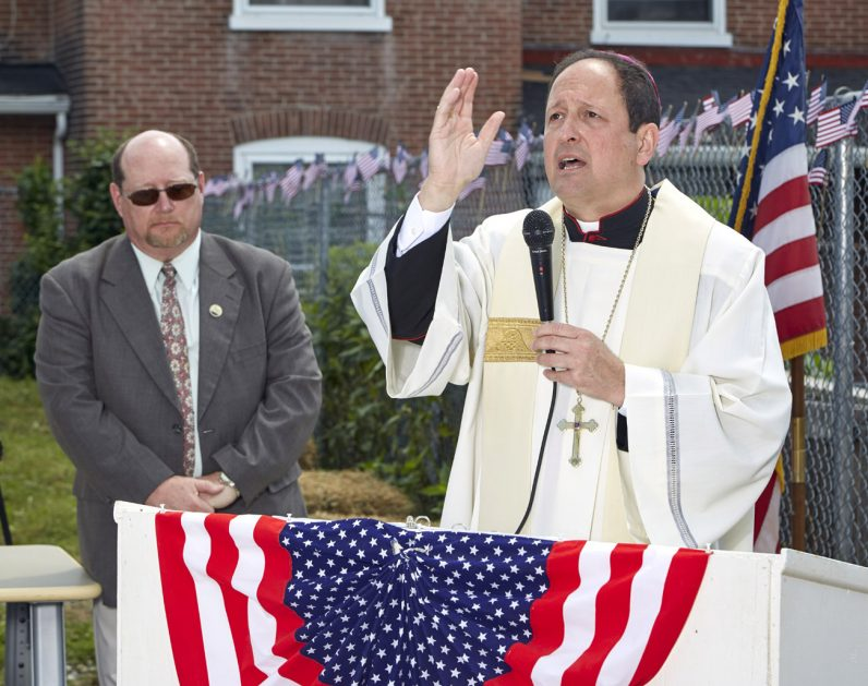 Bishop John McIntyre offers the blessing at Operating Base Cecilia in Coatesville.