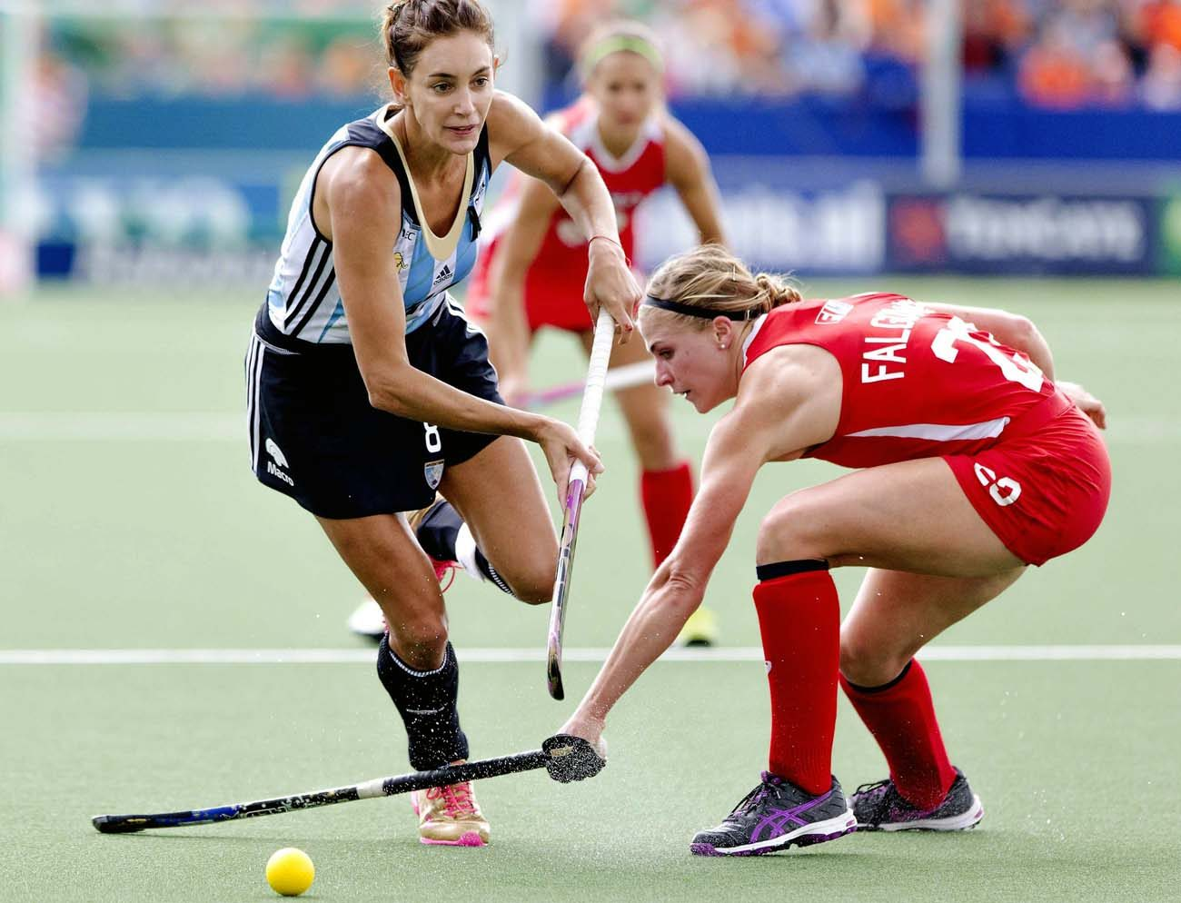 Katelyn Falgowski, right, is seen during the 2014 Field Hockey World Cup in The Hague, Netherlands. The 27-year-old graduated from St. Mark's High School in Wilmington, Del., and is going to Rio de Janeiro as part of the U.S.  women's field hockey team. (CNS photo/Sander Koning, EPA)