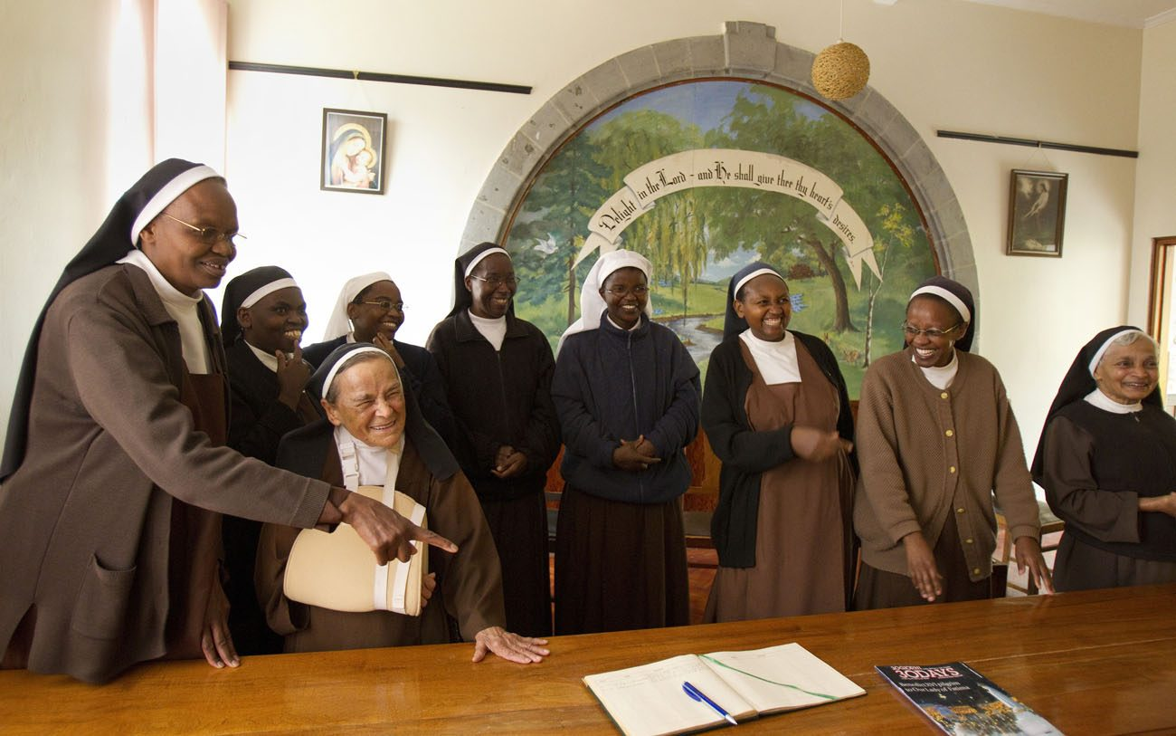 The Carmelite Sisters of Mount Carmel Convent in Nairobi, Kenya, ask their visitors from the United States to sign their guest book in this 2011 file photo. Pope Francis issued a series of new rulings dealing with formation, assets, prayer life, authority and autonomy of contemplative women. (CNS photo/Nancy Wiechec)
