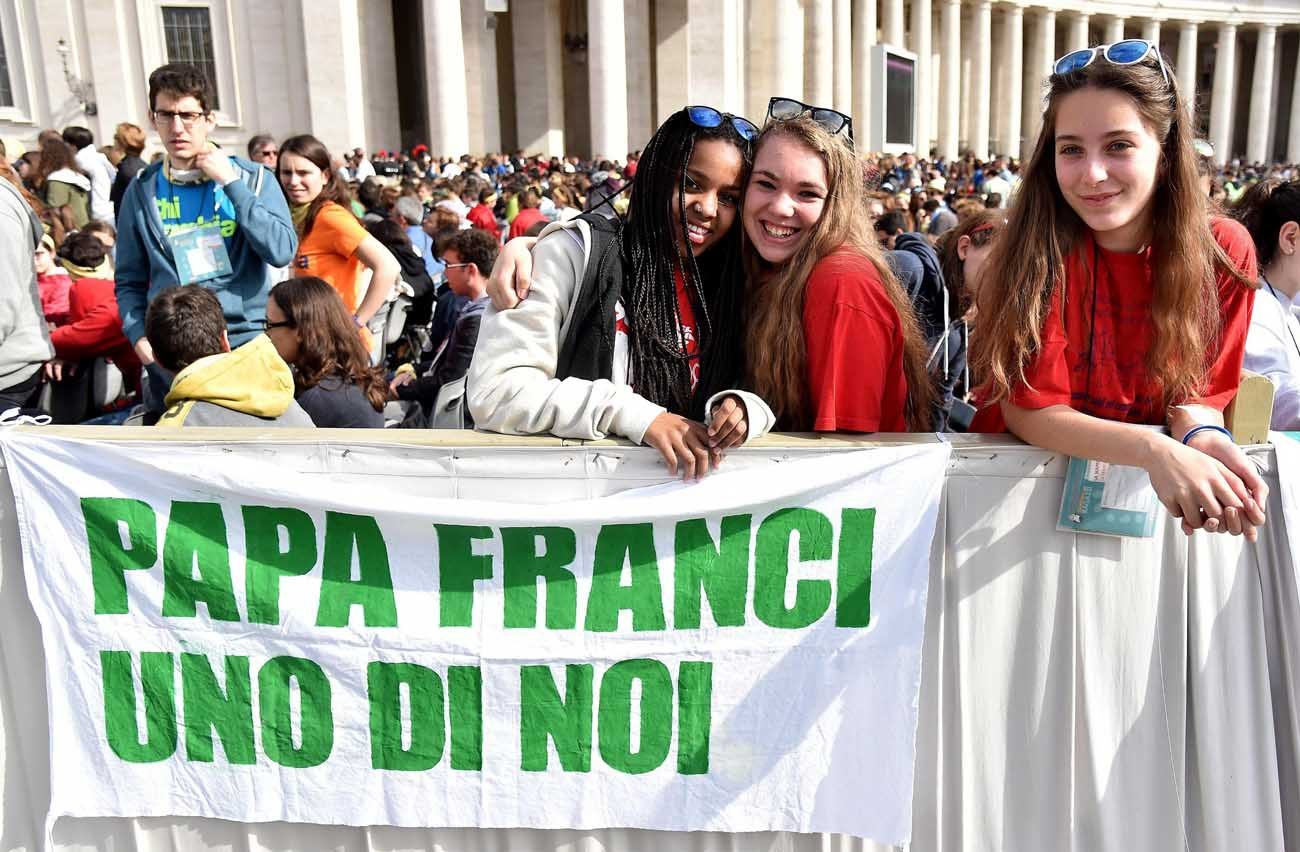 "Young pilgrims display a banner that says ""Pope Francis One of us"" as the pontiff celebrates an April 24 Mass for the Youth Jubilee in St. Peter's Square at the Vatican. (CNS photo/Ettore Ferrari, EPA)"