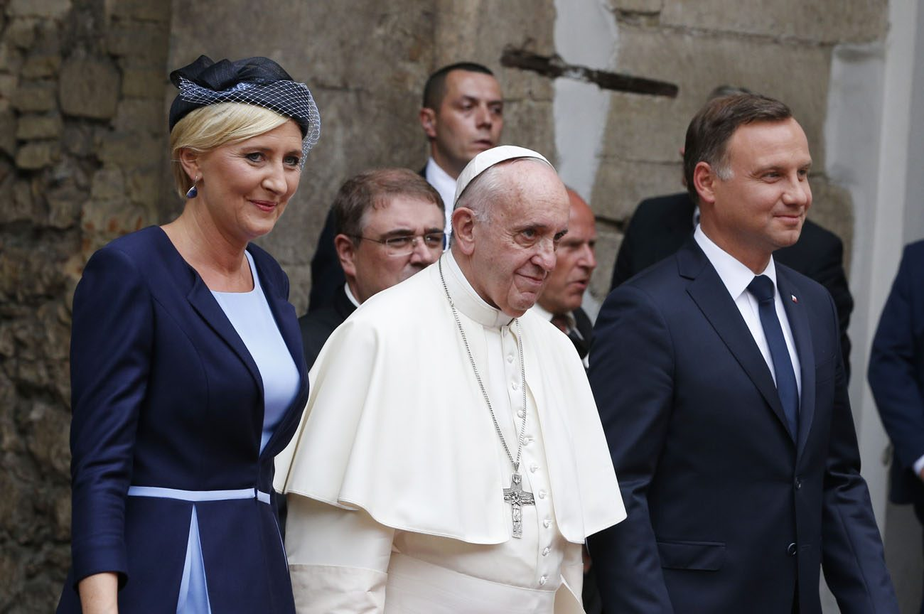Pope Francis, Polish President Andrzej Duda and first lady Agata Kornhauser-Duda arrive for a meeting with government authorities and the diplomatic corps in the courtyard of Wawel Royal Castle in Krakow, Poland, July 27. (CNS photo/Paul Haring)