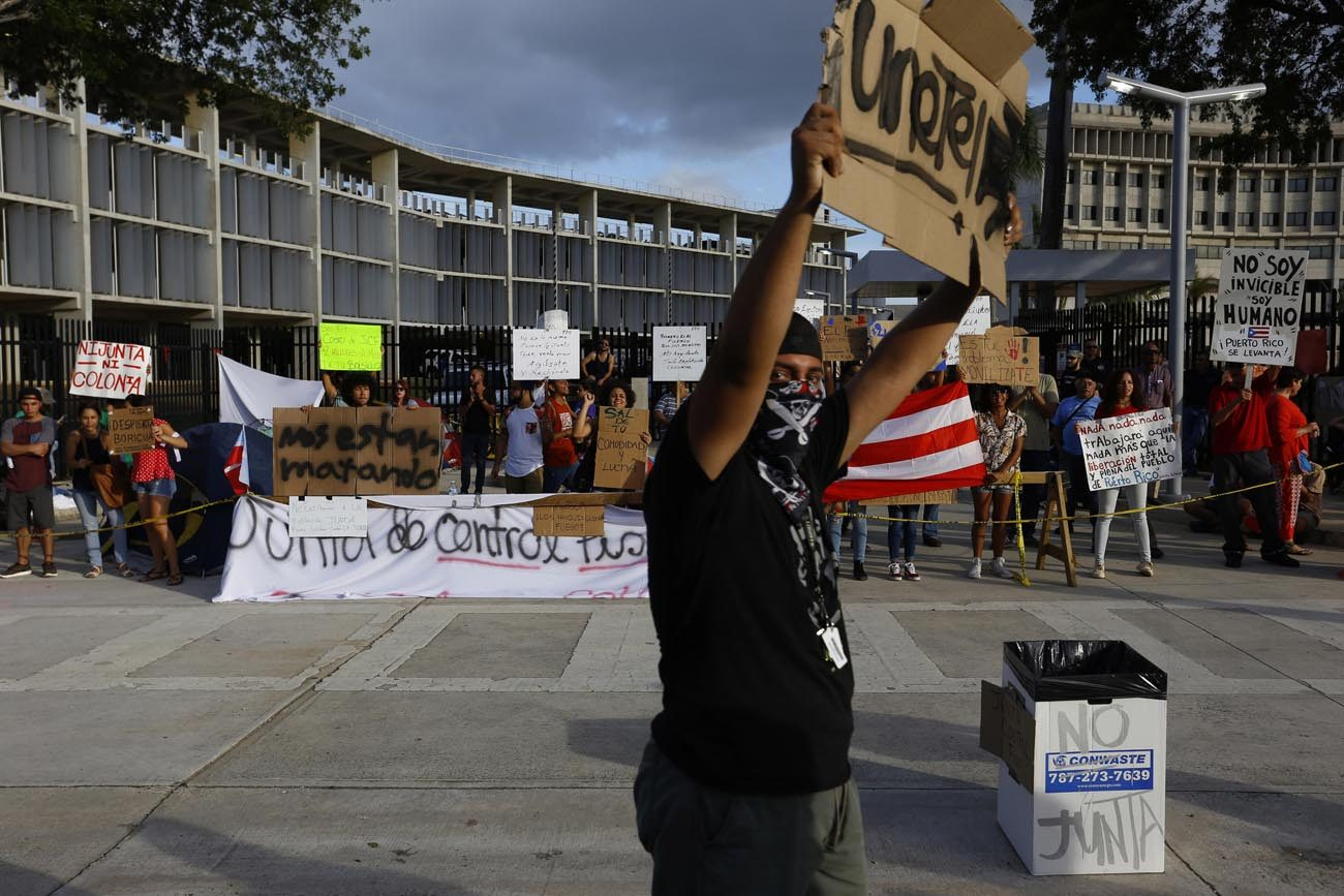 People in San Juan, Puerto Rico, demonstrate June 30 against creditors trying to take control of the island nation's assets. (CNS photo/Thais Llorca, EPA)