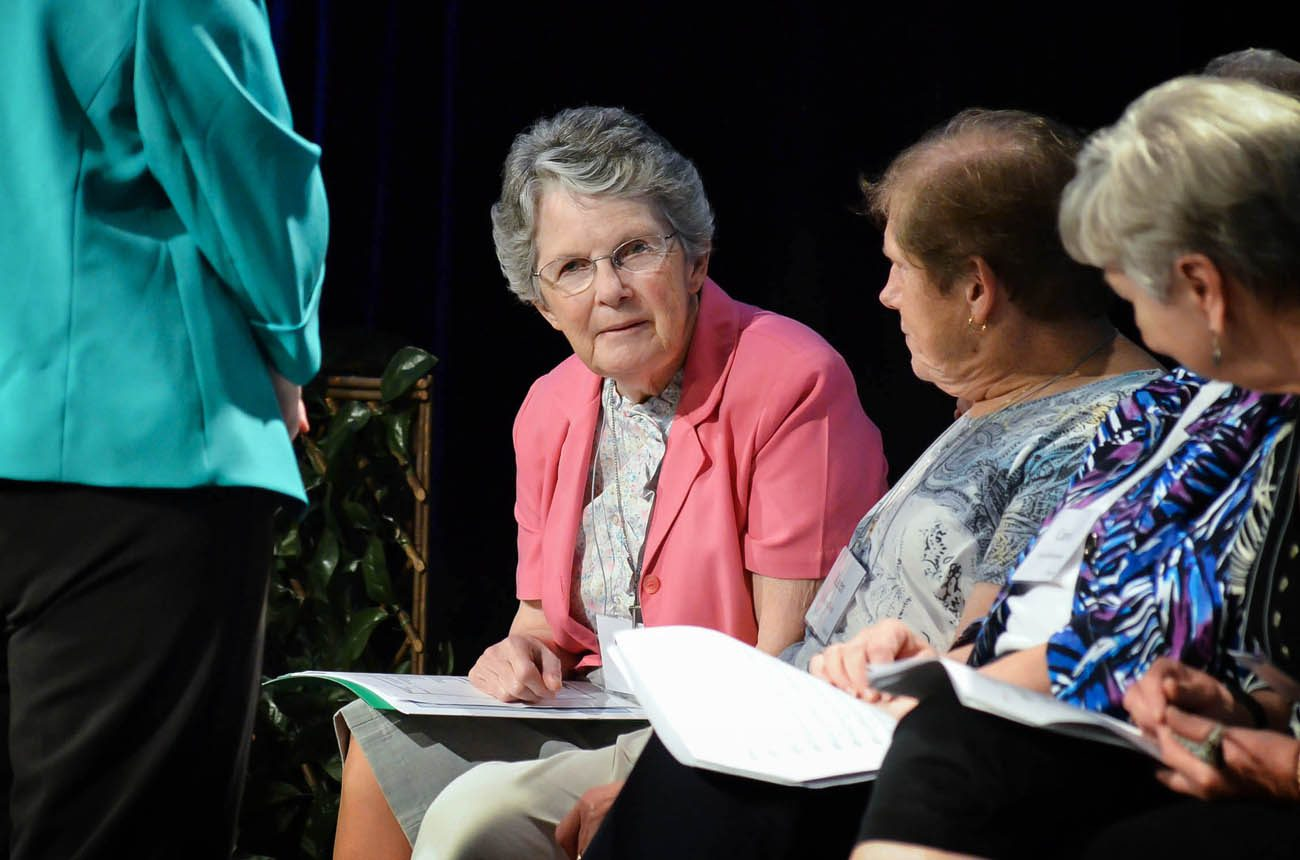 Sister Kathleen Power, a Sister of St. Joseph and assistant vocations director for the Diocese of Orlando, Fla., talks with other speakers July 9 during the 2016 conference of the U.S. Federation of the Sisters of St. Joseph in Orlando. (CNS photo/Andrea Navarro, Florida Catholic)