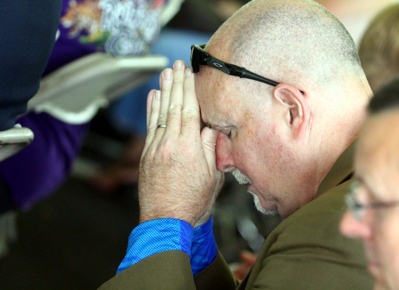 David Bolgiano prays during Mass.