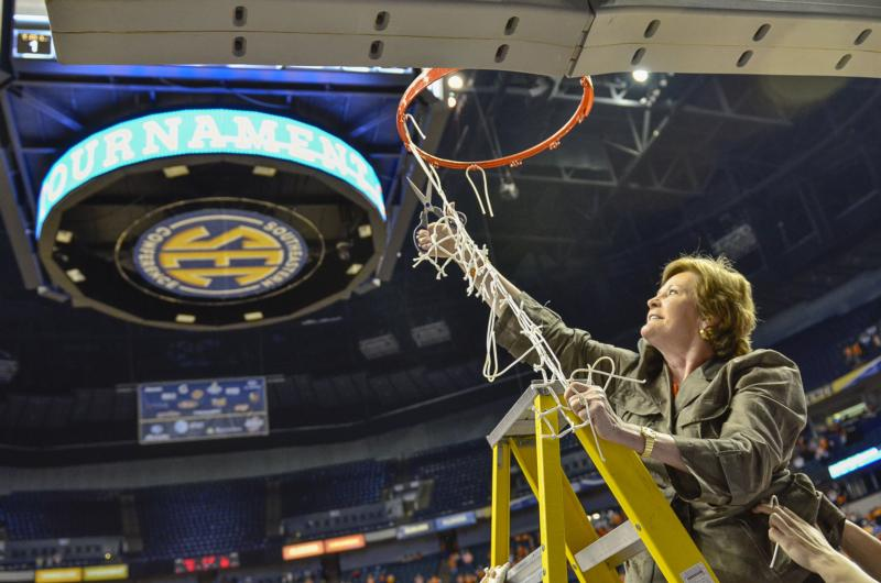 Hall of Fame coach Pat Summitt cuts the net after winning the 2012 SEC tournament, her last as head coach of the University of Tennessee Lady Vols. Summitt, a pioneer of women's college basketball who guided the Tennessee Volunteers to eight national titles in her 38 seasons at the university, died June 28 at age 64. (CNS photo/Patrick Murphy-Racey, Tennessee Register)