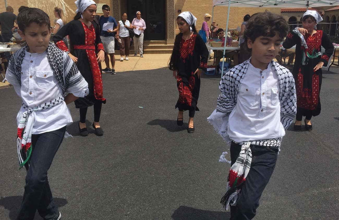 Children from the Kufiyah Dabke Troupe dance at the Franciscan Monastery of the Holy Land in Washington July 16. The monastery was the setting of the Holy Land Festival, which seeks to highlight the plight, but also the beauty, of the culture of Palestinians in the Holy Land. (CNS photo/Rhina Guidos)