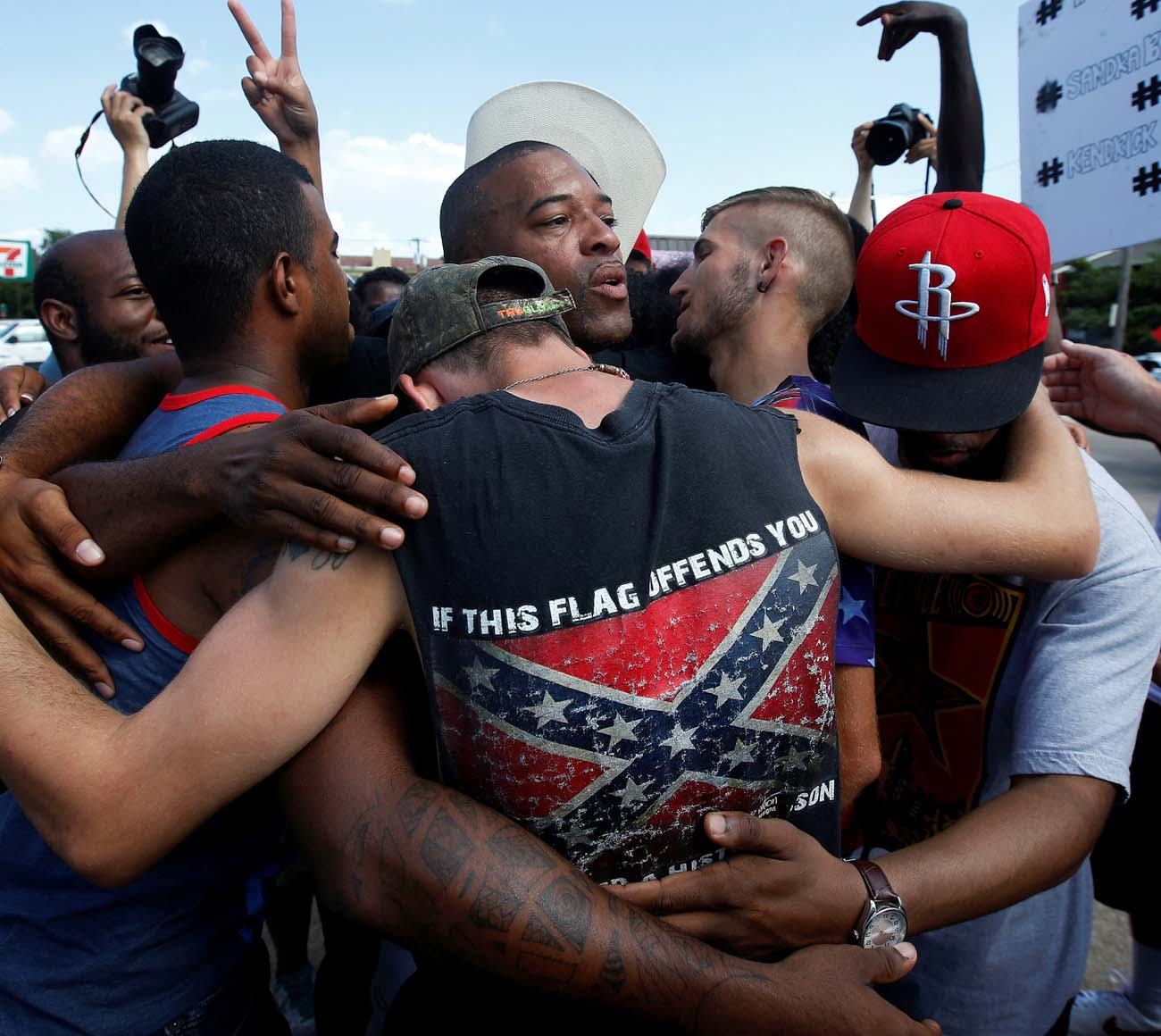 "African-American and white men embrace after taking part in a prayer circle July 10 following a Black Lives Matter protest in Dallas. Theologians and justice advocates have called upon the church to better address racism as a life issue and see it as an ""intrinsic evil."" (CNS photo/Carlo Allegri, Reuters)"