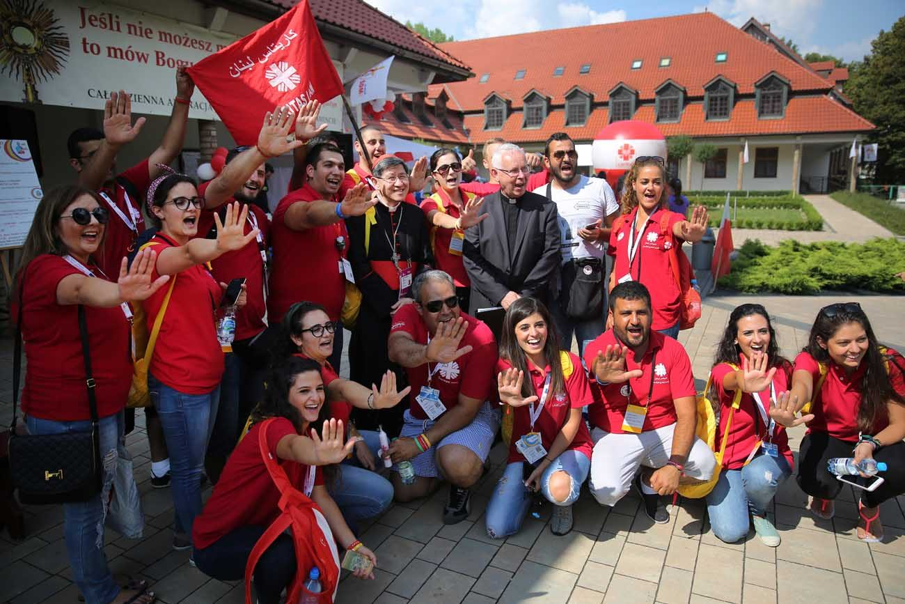 World Youth Day pilgrims with Caritias Lebanon pose with Philippine Cardinal Luis Tagle of Manila July 27 at St. Joseph Church in Krakow, Poland. (CNS photo/Bob Roller)