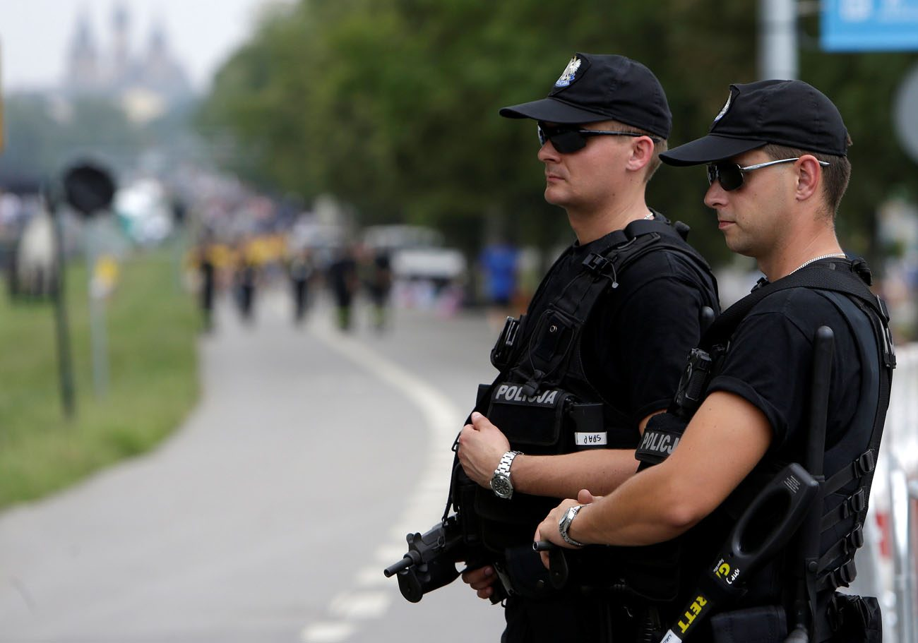 Police officers stand guard during World Youth Day in Krakow, Poland, July 26. Mariusz Ciarka, spokesman for Poland's Warsaw-based police headquarters, said Polish police have raised the official threat level after an Iraqi man was arrested with traces of explosives. (CNS photo/David W. Cerny, Reuters)