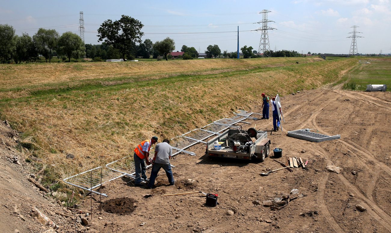 Workers install security barriers at the site of Campus Misericordiae in Brzegi, Poland June 15. (CNS photo/Grzegorz Momot, EPA)